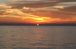 Zonsondergang bij het overzees Stock Foto's