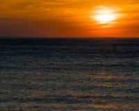 Zonsondergang bij Ovaal Strand Stock Afbeeldingen