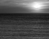 Zonsondergang bij Ovaal Strand Stock Foto