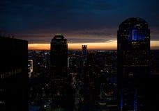 Zonsondergang bij stad Stock Foto