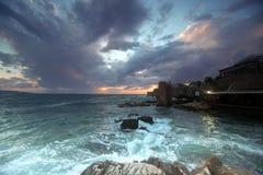 Zonsondergang bij stad van Acre, Israël Stock Afbeelding