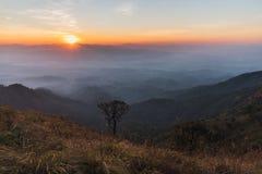 Zonsondergang bij top Stock Afbeelding