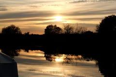 Zonsondergang bij Vlootdijk Norfolk Broads Stock Afbeelding