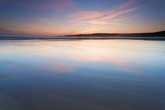Zonsondergang bij Zoetwater het Westenstrand stock fotografie