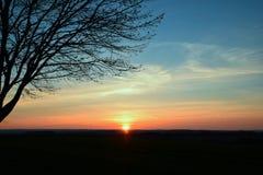 Zonsondergang boven het gebied Stock Afbeelding