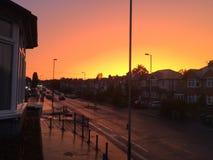 Zonsondergang buiten venster Royalty-vrije Stock Afbeeldingen