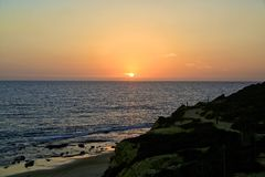 Zonsondergang Crystal Cove Newport Beach California stock foto's