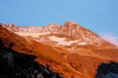 Zonsondergang in de berg Stock Foto