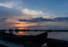 Zonsondergang in de Delta van Donau Stock Afbeeldingen