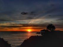 Zonsondergang in de vorm van Californië de Oceaan stock fotografie