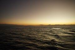 Zonsondergang in de Vreedzame Oceaan Stock Afbeelding