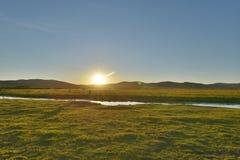 Zonsondergang in de Weide van Hulun Buir Stock Foto