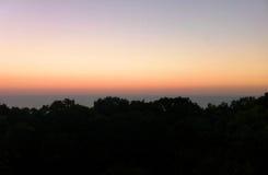 Zonsondergang dichtbij het Overzees Stock Afbeelding