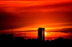 Zonsondergang die de blokken behing Stock Foto