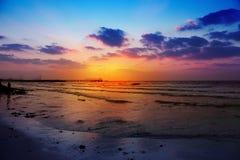 Zonsondergang in een strand Stock Foto