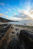 Zonsondergang in een strand Portugal Stock Foto