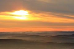 Zonsondergang en bergen Stock Foto's