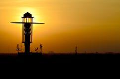 Zonsondergang en een Post van de Lamp Royalty-vrije Stock Fotografie
