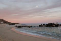 Zonsondergang en Moonrise Los Cabos Mexico Stock Foto's
