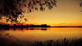 Zonsondergang en oranje hemel Stock Foto