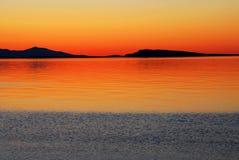 Zonsondergang en overzees stock afbeelding