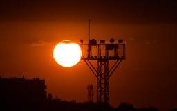 Zonsondergang en toren Stock Foto's