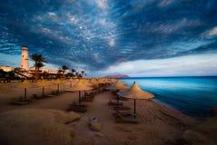 Zonsondergang en turkooise oceaan royalty-vrije stock afbeelding