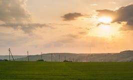 Zonsondergang en Weide Stock Foto