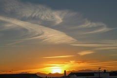 Zonsondergang en wolk stock foto