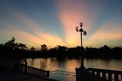 Zonsondergang en zonlicht Stock Afbeelding