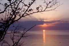 Zonsondergang in het overzees stock afbeeldingen