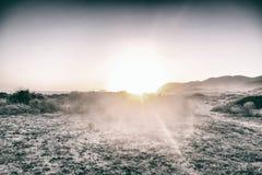 Zonsondergang in het strand Royalty-vrije Stock Foto's