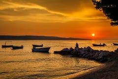 Zonsondergang met de boten Royalty-vrije Stock Foto's