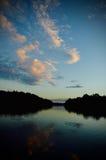 Zonsondergang met Vissersboten op het Meer Royalty-vrije Stock Foto's