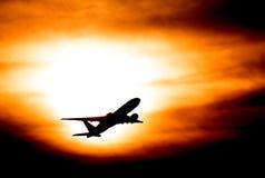 Zonsondergang met vliegtuig Royalty-vrije Stock Foto