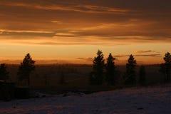 Zonsondergang na een sneeuwstorm Royalty-vrije Stock Foto's