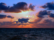 Zonsondergang in oceaan stock fotografie