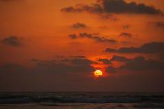 Zonsondergang onder het overzees Stock Fotografie