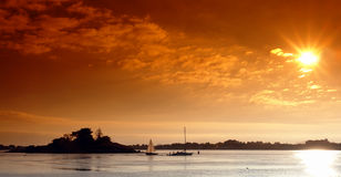 Zonsondergang op Bretagne golf Stock Foto's