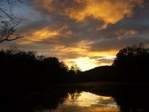 Zonsondergang op de caneyforkrivier Stock Foto's