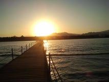 Zonsondergang op de pier Stock Afbeelding