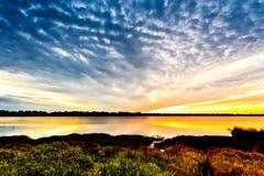 Zonsondergang op de rivier Tejo. Stock Foto