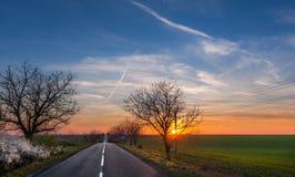 Zonsondergang op de weg Royalty-vrije Stock Afbeelding