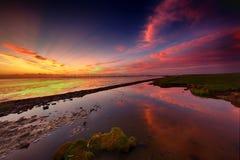 Zonsondergang op Dollard, het wadden overzees stock fotografie