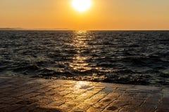 Zonsondergang op een dok stock afbeelding