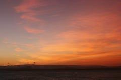 Zonsondergang op een eilandstrand Stock Fotografie