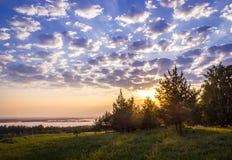 Zonsondergang op een rivier Royalty-vrije Stock Foto's