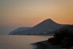 Zonsondergang op een strand Stock Foto
