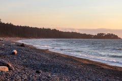 Zonsondergang op een strand Royalty-vrije Stock Foto