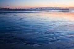 Zonsondergang op een strand in België Royalty-vrije Stock Foto's